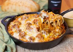 Skillet baked spaghetti and meatballs -- easy enough for a weeknight, fancy enough for the weekend!