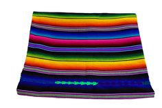 Our authentic Sonoran Serape blanket is woven using traditional techniques the hand stitched details throughout. Perfect as a throw blanket for the living room or beach, this Mexican blanket's colorful stripes add a pop of culture and color.