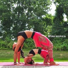 Inspiring Mother with her Young Daughter Practising Yoga
