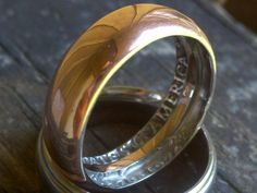 A lot of people are talking about coin rings, which are made by hammering the edge of a coin with a hammer. Try using a spoon and some patience.