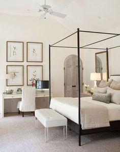 black metal frame bed in a neutral room catches an eye