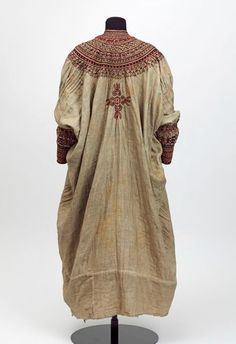 Africa | Back of a woman's dress. Abyssinia, ca 1860 | Cotton, embroidered with silk || This dress was taken by British troops at the siege of Magdala (Mek'dala) in 1868. It is said to have belonged to Queen Woyzaro Terunesh, the second wife of the Ethiopian emperor Tewodros (Theodore), and mother of the prince Alamayehu.
