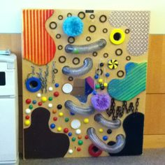 Sensory wall in MIND Institute waiting room...how could you not play with that? It's awesome!