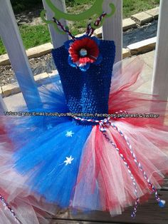Stars and stripes July 4th tutu dress was created by Angie at Tutus 2 You.  I create everything from dress up tutus to pageant dress, hair bows to hair bow holders and tulle wreaths along with everything in the middle.  I have often giveaways on my facebook page.  Come check me out!