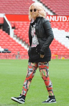 Not blending in: The teen star clearly wanted to make an impact in the eye-catching ensemble, pairing the leggings with a hoodie and leather jacket before performing before a charity football match