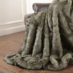 Tawny Fox Faux Fur Throw Blanket from Wayfair A touch of ultimate luxury, this stunning throw evokes the glamour of old Hollywood. It is the perfect accent piece for sofas, beds or loungers. This substantial faux fur throw is unbelievably soft and adds a touch of warmth and elegance to any room.