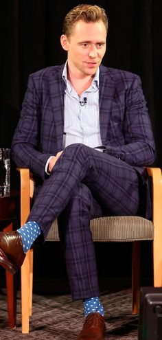 "The Hollywood Reporter: Dude Du Jour: Tom Hiddleston Pulled Off 3 Prints at the Same Time. ""The Suit: A plaid navy Etro suit, styled with a sky blue pinstripe shirt, cognac Louboutin shoes and blue-and-white polka dot socks.  The Wearer: English heartthrob Tom Hiddleston."" Link: http://www.hollywoodreporter.com/news/tom-hiddleston-wears-3-patterns-883171"