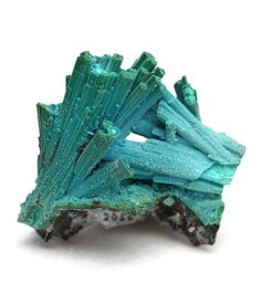 Chrysocolla ps. after Gypsum.  ChrysocollaUses: preventing ulcers, digestive problems, arthritic conditions, strengthens lungs and thyroid, enhances metabolism, female disorders, alleviates fears, guilt, tension, mental clarity in psychic work.