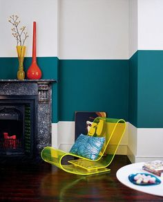 by Jodi Mckee: teal stripe wall + yellow lucite chair + orange & yellow vases