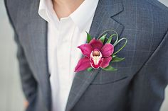 Boutonniere: Red cymbidium orchid with bear grass loops Orchid Boutonniere, Boutonnieres, Prom Flowers, Cymbidium Orchids, Groom And Groomsmen, Pet Grooming, Buttonholes, Corsage, Grass