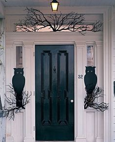 scary halloween front door, could maybe cut up extra large trash bag for front door instead of painting black