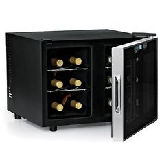 """Touchscreen Silent Two Temp 12 Bottle Wine Fridge Details: Sleek and stylish, this touchscreen wine cooler boasts a reflective smoked thermopane glass door, 4 chrome pull-out shelves, super bright interior LED lighting, and an ultra-quiet thermoelectric cooling system. With a 12 bottle wine storage and two temperature zones adjustable between 46-65°.  Keep your white and red wines each at the perfect temperature. Eco-friendly. Measures 15.25""""x19.75""""x19½""""."""
