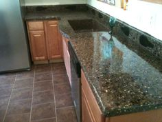 Glass Bottle Concrete Countertops | Recycled Beer Bottle Terrazzo with Melted Bottle back splash
