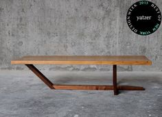 A single 100+ year old oak slab atop a solid NC walnut cantilever base makes for the coffee table byElijah Leed Studio.