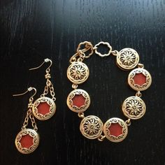Gold plated bracelet and earring set. Gold plated bracelet and earring set with reddish brown inlays. Nice vintage looking pieces that can be worn on two sides for two different looks. Worn once. Bought from Premier Designs. Premier Designs Jewelry Bracelets