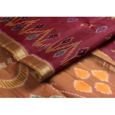 Rich #maroon is always #classic - #especially with a mustard border and with #Ikat motifs woven all over!