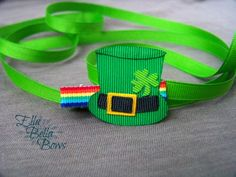 **You are buying one Lucky Leprechaun Hat hair clip, made to order**  This adorable little Leprechaun hat hair clip is perfect for some Irish flare. I use only quality ribbon, and all ends are sealed to prevent fraying.  ***** See my other listings for my Shamrocks and Clovers. *****  Hair Huggers are added to alligator clips to help with gripping fine hair at no extra cost.  Thank you for shopping Ella Bella Bows