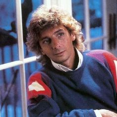 Barry Manilow posing for a picture.