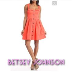 Betsey Johnson Sweetheart Dress in Melon Melon/orange colored sweetheart neckline swing dress. Adorable black and gold heart shaped button detail down the front. Elasticized back with side zipper closure. Worn one time. No visible signs of wear. Betsey Johnson Dresses