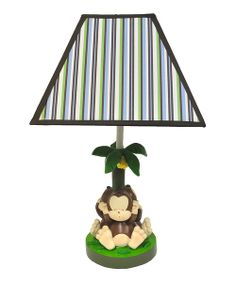 Create a jungle oasis in any little one's playroom or bedroom with this silly monkey lamp! The stunning stripes on the shade combined with the whimsical base put a pop of color into décor.
