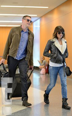 "A source tells E! News the couple looked ""very happy, smiling the entire time"" as they prepared to depart LAX"