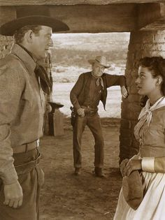ANGEL AND THE BADMAN - Gail Russell & John Wayne have a conversation while lawman Harry Carey Sr. stands in the doorway - A John Wayne Production - Written & directed by James Edward Grant - Republic. Iconic Movies, Old Movies, Harry Carey, Iowa, Republic Pictures, John Wayne Movies, John Ford, Tv Westerns, Rare Photos