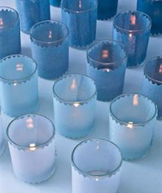 Light Your Spread with Lots of Votives (Wrap glass holders in different shades of the same color to create and ombre arrangement.)