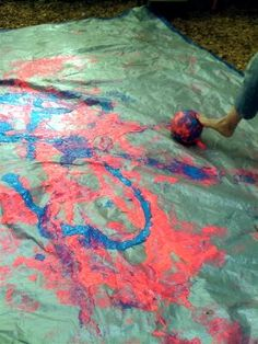 """really big """"marble painting"""", kicking a ball through the paint"""