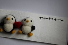 Ridiculously expensive felted wool penguin greeting card. I really like it but for $55.59 by needlenerd on Etsy, I think I'll learn to live without.