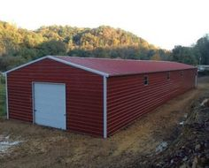 Red Metal Garage with Vertical Roof - Elite Metal Structures Shipping Container House Plans, Shipping Containers, Barn Loft, Steel Barns, Agricultural Buildings, Roll Up Doors, Metal Garages, Loft House, Metal Structure