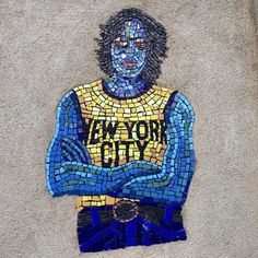 "16 Incredible Celebrity Murals Spotted Around NYC #refinery29  http://www.refinery29.com/celebrity-murals-nyc#slide-15  Who: John LennonWhere: East Harlem; near the corner of 105th Street and Lexington Avenue. Art By: Manny VegaA blue mosaic of John Lennon — in a cab-colored tank top — is just one of the figures who appear in Manny Vega's Harlem creation ""Espiritu."" ""The purpose..."