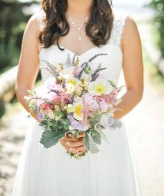 Colorful summer #bouquet Photography: Blue Rose Photography - bluerosepictures.com  Read More: http://www.stylemepretty.com/2014/07/30/summer-seattle-wedding-at-golden-gardens/