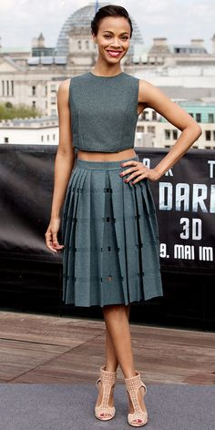 Zoe Saldana WHAT SHE WORE Zoe Saldana looked over Berlin in a wool flannel shell and pleated skirt from Calvin Klein Collection, a vine Jennifer Behr headpiece and perforated Jimmy Choo sandals.