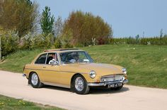 MGB/GT again. As pretty as the roadsters were, the GTs were all that much more beautiful. A work of art.