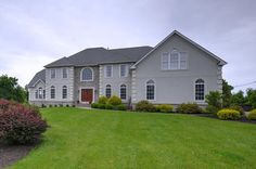 Sprawling colonial sits on a beautiful 3 acre property, adjacent to a golf course.