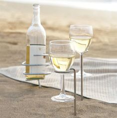 Bottle and glassware holders for the beach from True Fabrications (Picnic Stix Set on Amazon) $12.09