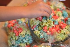 Fruity Kool-Aid Candied Popcorn- Fun, fruity and addictive! Grab your favorite Kool-Aid flavor and pop up a batch today! The kids love it and the adults do too. It has that wonderful salty/sweet combination that grownups appreciate too! Perfect for birthday parties, school treats or pop up some team colors for the big game