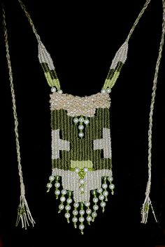 Green/Beige Pearl - 2014 - Adjustable length - Available. Woven by Terri Scache Harris, theravenscache.shutterfly.com Hand woven, handwoven, weaving, weave, needleweaving, pin weaving, woven necklace, fashion necklace, wearable art, fiber art.