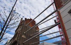 Not Art. Houses held up by metal girders, Oxford Street, London