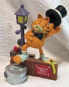 """Garfield Figurine: """"Midnight Serenade"""" in Hiden_Treasures7641's Yard Sale in Arlington , TX for $10. Danbury Mint limited addition Jim Davis Garfield Collectable Figurine!Add one or more of these vibrantly colored figurines to your collection for only 10.00 each! Each mini statue measures approximately 4 1/2-inch tall, and feature that grumpy adorable cat that we all know and love, doing what he does best! All items are in excellent or very good condition! Unfortunately, due to priva ..."""
