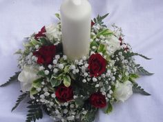 a red rose and white candle table arrangement made by myself