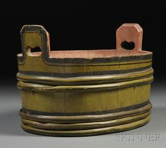 Green-painted Oval Staved Wooden Tub with Black Striping, early 19th century, stave and lapped bentwood hoop constructed tub with extended staves with pierced handholds, with red-painted interior, (one hoop repaired), ht. 8 1/2, dia. 13 1/4 in.