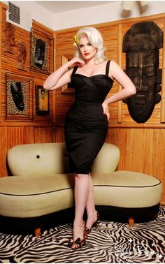 The Vamp Dress in Black by Deadly Dames | This dress sizzles with a sculpted bust and fitted waist that enhances your figure and boosts your bustline along with adjustable straps that let you customize the top for a range of bust sizes. Non-stretch cotton sateen in solid black with just a touch of spandex for comfort and fit. Finished off with a zipper and hook closure in back. - See more at: http://www.pinupgirlclothing.com/vamp-dress-black.html#sthash.NtNKsxf5.dpuf