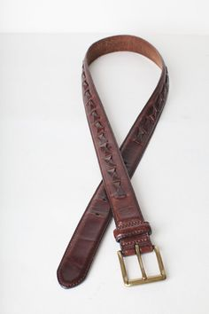 Vintage Mens Fossil Leather Belt Belt is in good condition and measures 42.75 inches from end to end 34.5 inches to first hole and is 1.25 inch wide. Belt has a solid brass buckle. Find more belts in the shop here: https://www.etsy.com/shop/doubleprints?section_id=11896445