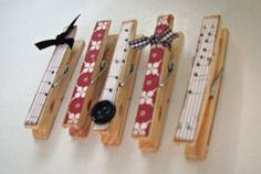 Clothespins either decorated with ribbon or buttons or BOTH! Hold up pictures or placecards or something!