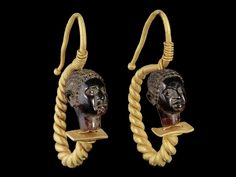 African Head Earrings        A pair of Roman gold and garnet African head earrings, circa 1st-2nd century A.D.