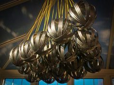 Tin Can Chandelier by William White. Ceiling decoration crafted ...