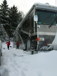 Snow in winter RVing.   (We sympathize, as our site has been under a couple of feet of snow since December and, despite a heated roof, digging is getting old. This year is bad...)