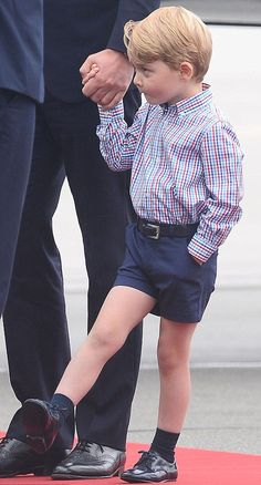 Prince George of Cambridge seemed a little underwhelmed by the formality of the occasion and was seen fidgeting and swinging his legs as his father received an official welcome