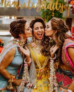 Love this picture of Indian bride with her bridesmaids in colourful lehengas. April Brides Issue features one stunnning Sabyasachi Bride along with a New Budget Lehenga Brand with Lehenga Prices + Bonus: Mumbai Budget Photographer. Bridal Poses, Bridal Photoshoot, Wedding Poses, Photoshoot Ideas, Wedding Ideas, Bridesmaid Poses, Bridesmaid Pictures, Indian Wedding Photography Poses, Photography Couples